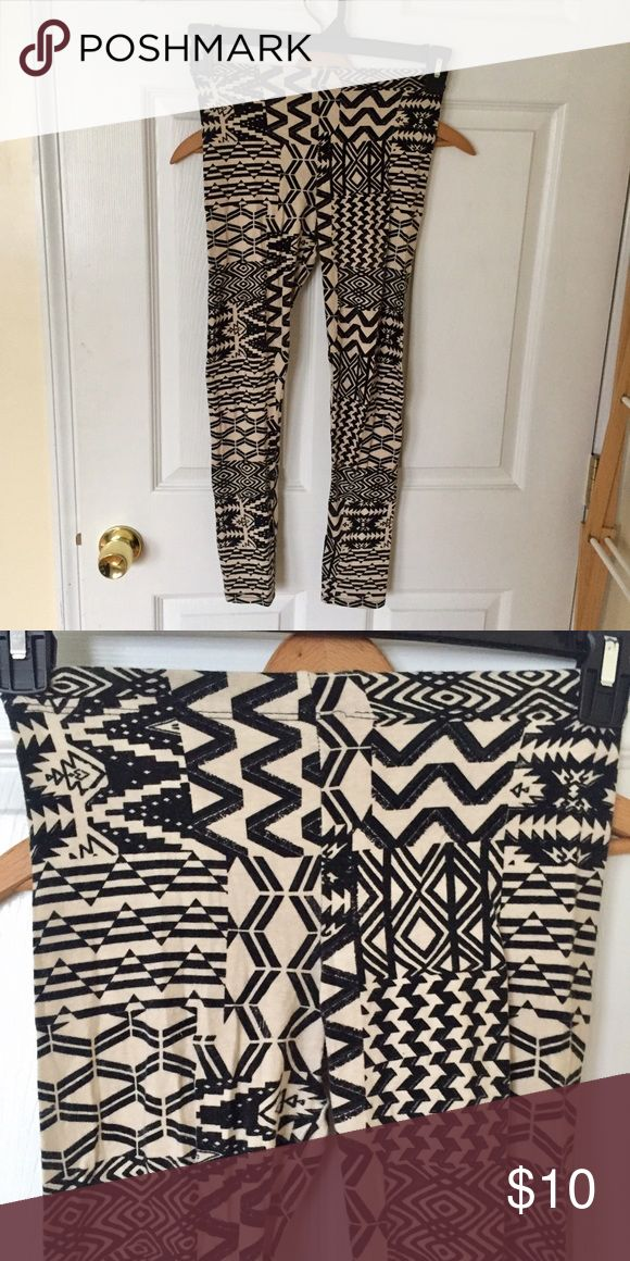 Cream/black tribal print leggings Cream and black colored tribal print leggings. Don't know the exact material it is made out of because tag is worn. But feels more like cotton. Size small. Gently worn. Pants Leggings