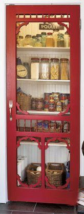 Replacing a solid pantry door with a Victorian style screen door. The handle is a fork! Cute idea for a country kitchen.
