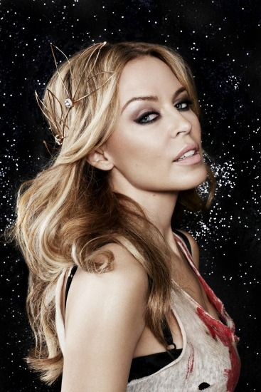 Kylie Minogue...beautiful natural makeup look w/ emphasis on a dramatic eye.