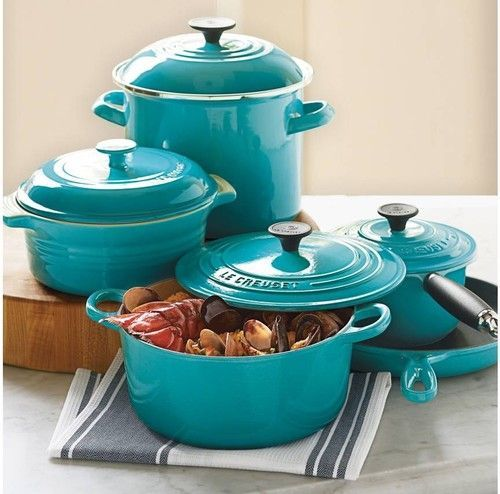 Le Creuset 9-Piece Cookware Set eclectic cookware and bakeware.. for when we settle in one place, have a feeling we will have worn out the orange  LC dutch oven by then!
