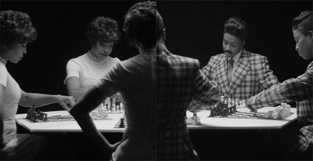 "Lorna Simpson, ""Chess,"" 2013. HD video installation with three projections, black & white, sound, 10:25 minutes (loop). Score and performance by Jason Moran. Courtesy the artist; Salon 94, New York; and Galerie Nathalie Obadia, Paris/Brussels. © Lorna Simpson."