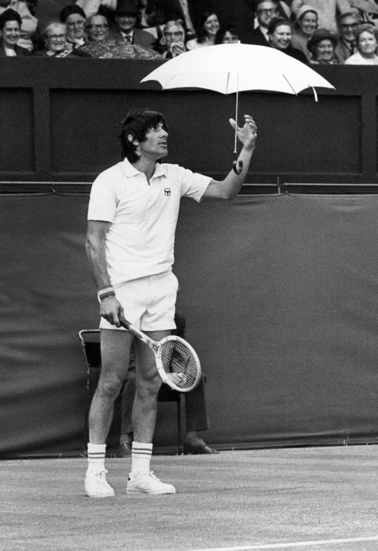 Ilie Nastase - 1974 Wimbledon Men's Singles Round of 16. Neither the umbrella nor the clowning did Nastase any good. He lost to Dick Stockton 5-7; 6-4; 6-3; 9-8