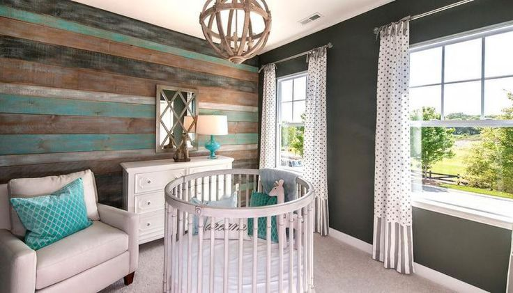 Nursery Room With Wooden Cladding And Round Baby Crib