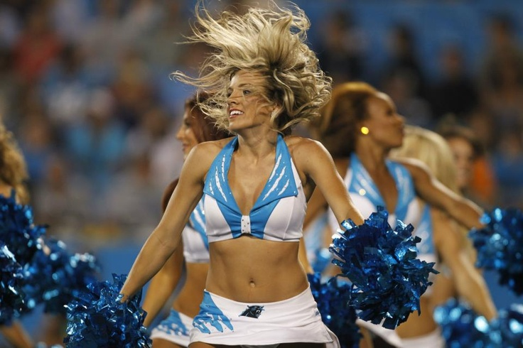 A Carolina Panthers cheerleader performs during the fourth quarter of a preseason NFL football game against the Miami Dolphins in Charlotte, N.C., Friday, Aug. 17, 2012. The Panthers won 23-17. (AP Photo/Bob Leverone) AP2012