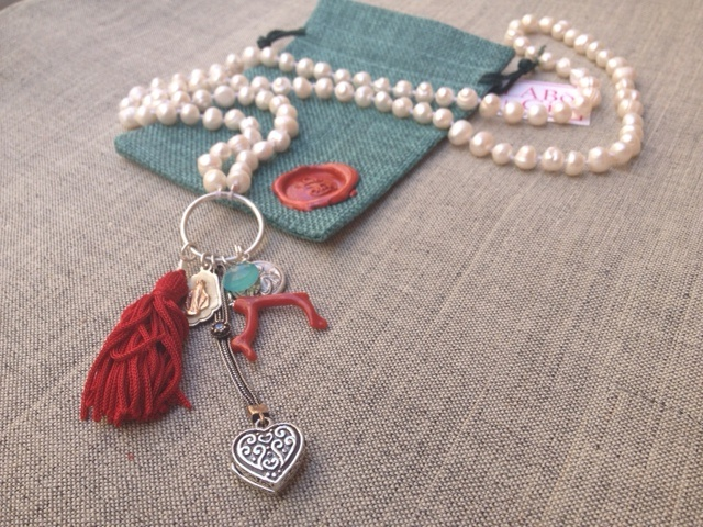 Unique Piece - Pearls necklace with silver charms, coral, chalcedony and a red silk tuft.