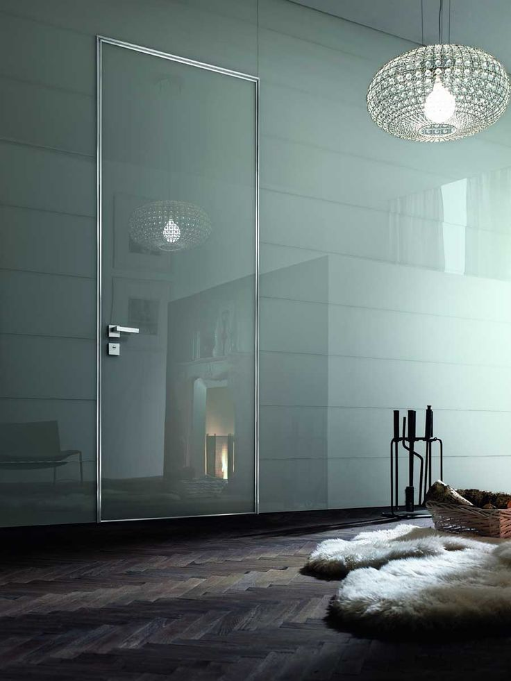 Project door by Oikos. Grey glass.