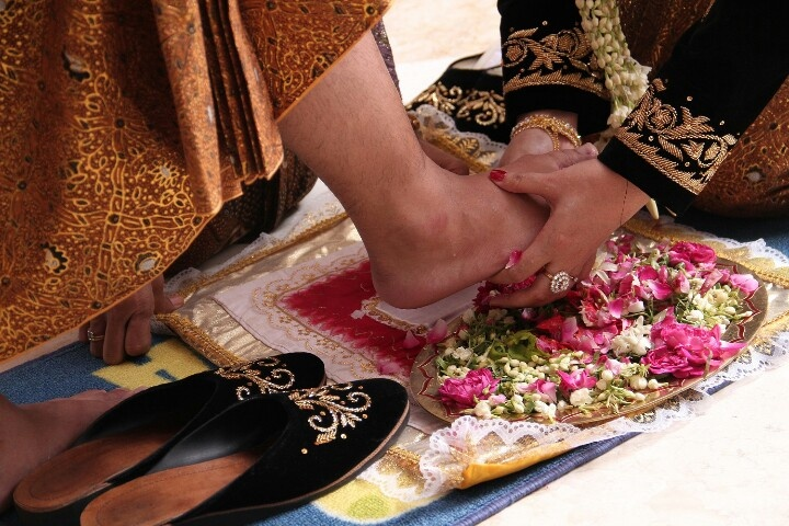 Javanese traditional wedding procession, Wiji Dadi, the bridegroom stepped on chicken eggs until broken then the bride will wash the feet of the groom with flower water.  this process represents a husband and father is responsible for his family.