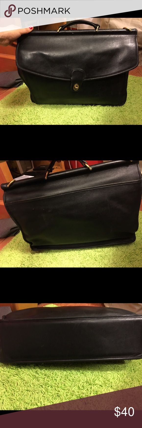 Black vintage coach briefcase. Black vintage coach briefcase. There is wear, tear and scratching. There is no strap. Measurements are: width is 16 inches, height is 13 inches and the side is 4 inches. Price is firm. Coach Bags
