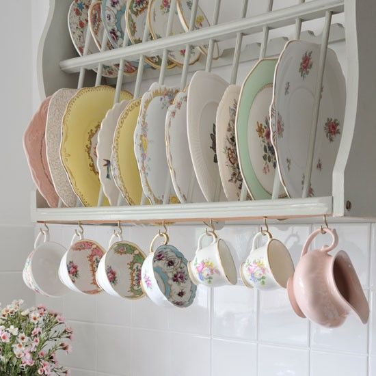 Plate rack with pretty vintage china in glorious pastel colours. Somebody get me off pinterest!
