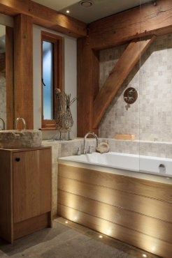 Beautiful bathroom in oak frame house by Roderick James Architects and Design Forum Interiors