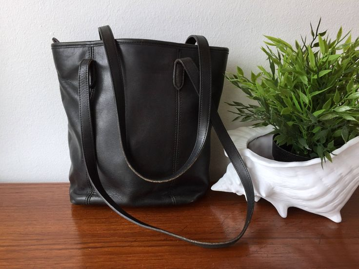 Coach Leather Shoulder Bag - All Black Leather Long Strap Small Shoulder Purse - Small Tote Black Leather Bag - Simple Bucket Style Handbag by ShopRachaels on Etsy https://www.etsy.com/listing/535168675/coach-leather-shoulder-bag-all-black