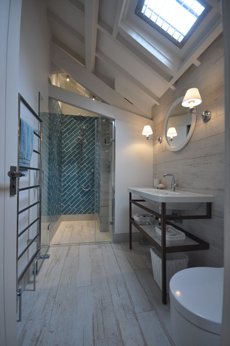 Awkward shower room breathes new life with plank style floor tiles and aqua glazed tiles