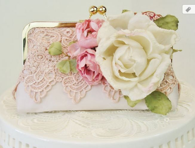 Love this sweet idea for embellishing a plain purse with pretty lace and artificial flowers! :)