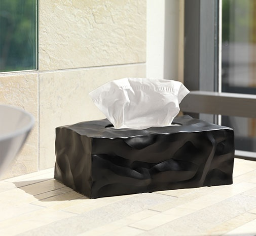Wipy II black by Essey. With crumpled surfaces visually communicating the content inside Wipy ll is now launched as cover for the rectangular tissue boxes.