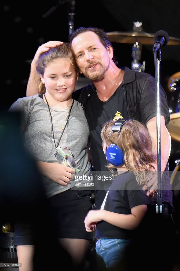 Recording artist Eddie Vedder (C) of Pearl Jam performs Happy Birthday to Olivia Vedder (L) with Harper Vedder (R) onstage at What Stage during Day 3 of the 2016 Bonnaroo Arts And Music Festival on June 9, 2016 in Manchester, Tennessee.