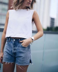 Denim shorts with white top.