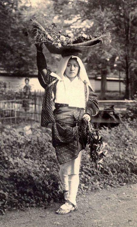 Flower vendor from Ohara, Japan. Early 20th century. Image via Okinawa Soba on Flickr