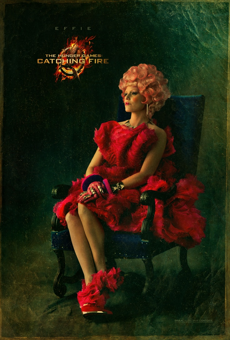 It's a big, big, big day... the elegant Effie Trinket. For the full gallery of #CapitolPortraits, make your way to www.CapitolCouture.pn