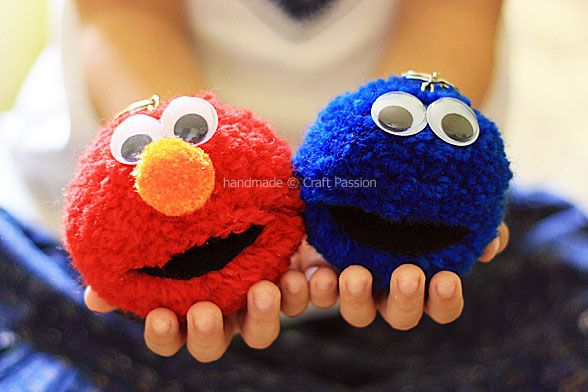 Elmo & Cookie Monster Pom Poms -- use a key chain to clip onto backpacks and lunch bags