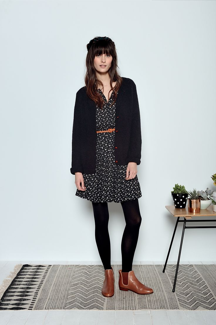 Black and white dress (patterned dress), black tights, brown boots, black cardigan, brown belt