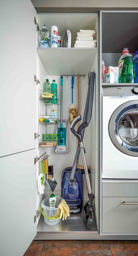 Love the durability and look of this stainless steel bottom shelf in this utility cabinet in the laundry room