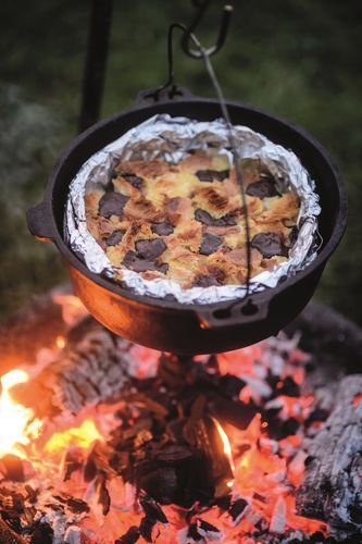 The idea for this bread and butter pudding with marmalade and chocolate from How To Eat Outside was conceived at the end of a week of camping when Genevieve Taylor was left with a collection of slightly sad-looking leftover bits of this and that – stale and on-the-turn ingredients in need of a good home, and what a home it turned out to be! A foil-lined springform cake tin placed inside a Dutch oven is the best way to cook this recipe.
