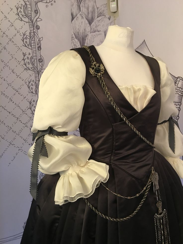 "Outlander: Claire's outfit that includes a CHATELAINE, which is basically an 18th-century ""utility belt"" for a woman."
