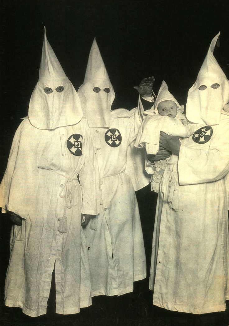 Interview, June 1991. Members of the extremist white supremacist group, the Klu Klux Klan, hiding their faces behind masks.