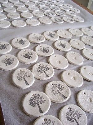 Salt Dough Gift Tags. Made with 1 cup of flour, 1/2 cup salt and 1/2 cup water. Knead, cut out shapes and hole for ribbon. Leave for 3 days to dry and then stamp!