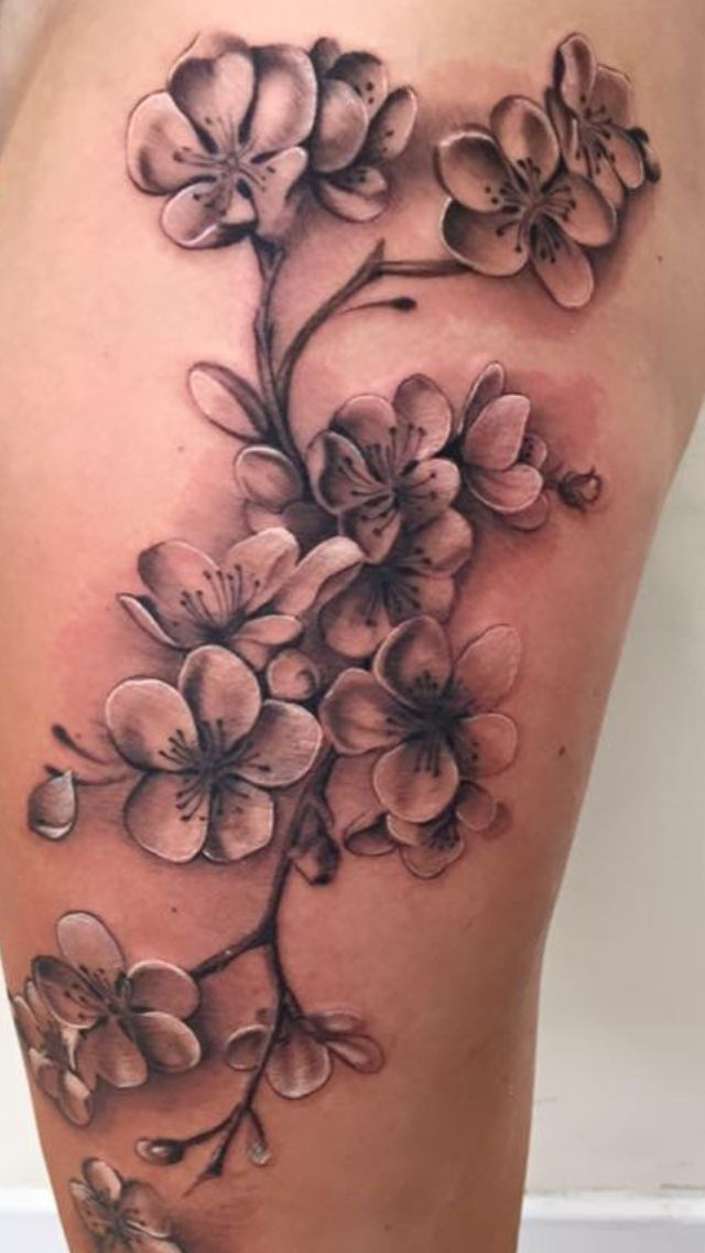 Cherry blossom on thigh in black and grey - by Nico Dray (The Worlds End) in Guernsey. ❤️