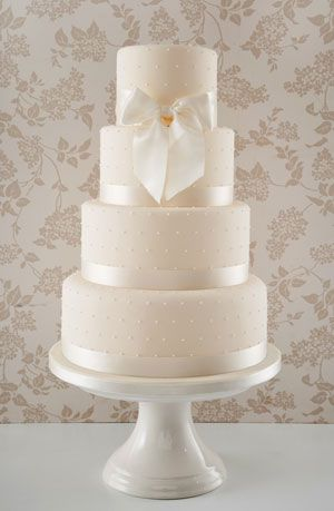 Simple Dots with Bow wedding cake, by Anna Tyler Cakes