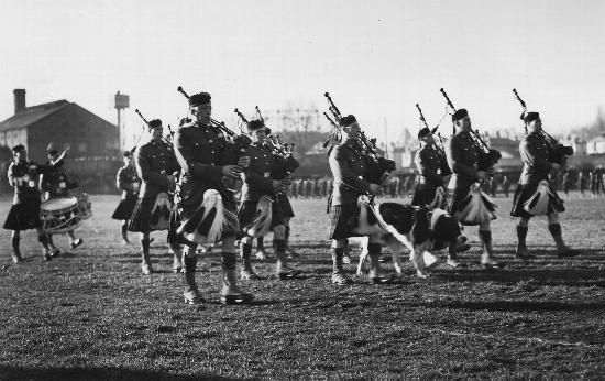 A march past of the 1st Canadian Scottish Regiment's pipe band with its mascot Wallace during an inspection by Her Royal Highness The Princess Royal. Britain. January 4,1944