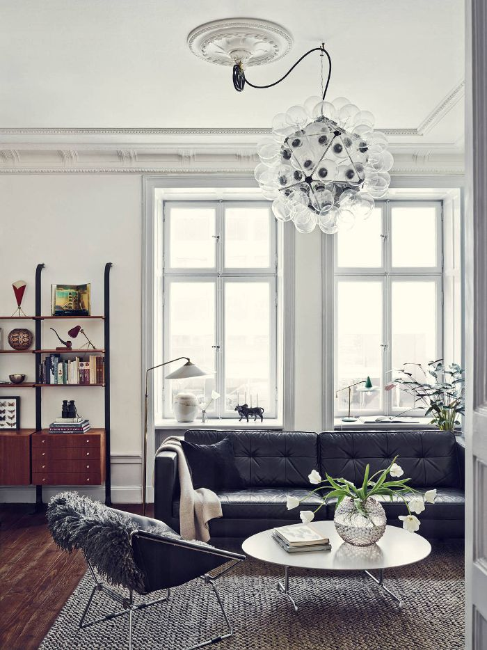 dustjacket attic: Interior Design | A Stockholm Apartment #blackleather #couch #woodfloor