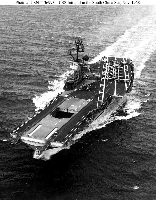 USS Intrepid (CVA-11) in her Attack Carrier guise, with a deckload of A-4's, A-1's and F-8's spotted aft as she prowls the South China Sea in November of 1968. [595x765]