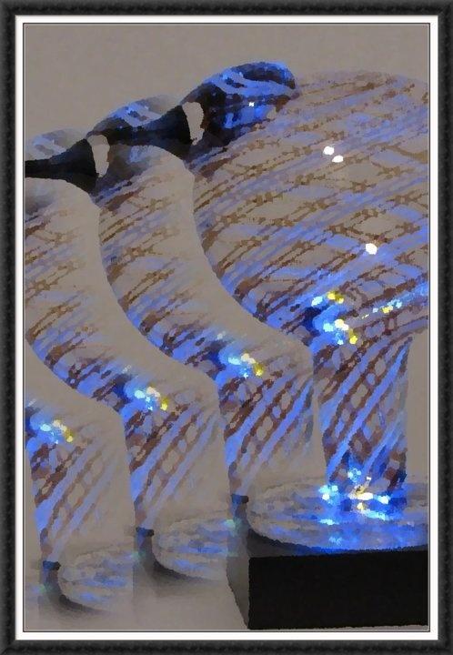 Blue light below Toikka glass bird edited in photoshop