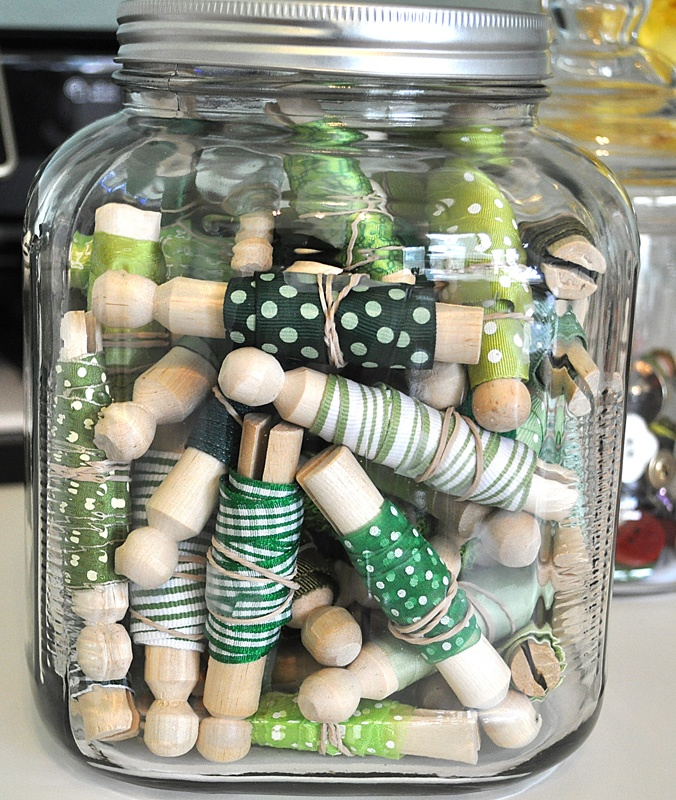 What to do with the ribbon leftovers--wrap them around clothespins and display in pretty jars!