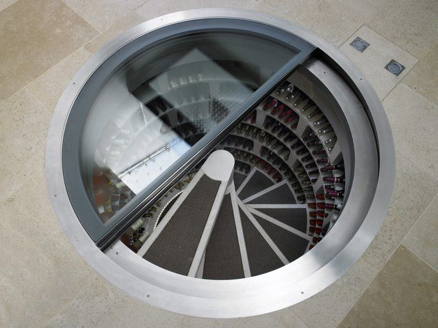 An entire Wine Cellar equipped with an unfolding staircase.  maybe one day...: Wine Rooms, Idea, Spirals Stairca, Stairs, Interiors Design, Spirals Wine, Wine Cellars, Shoes Closet, Winecellar