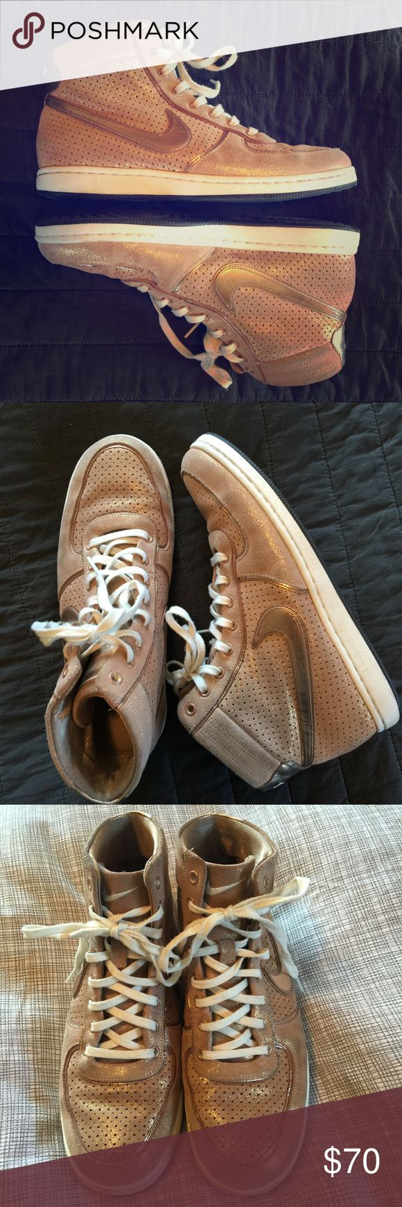 Rose Gold Nike High Top Sneakers 9! These shoes are just incredible. Nike rose gold high tops with a lot of shimmer! Women's size 9. In excellent preowned condition with no damage of any kind. Nike Shoes Sneakers
