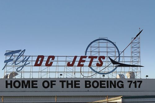 Googie style sign on the main Boeing hanger in Long Beach. The sign predates Boeing and originated with McDonald/Douglas. Boeing merged with MD several years ago and incorporated elements of this classic Googie in their new logo.