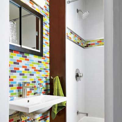 small remodeled bathroom with colorful glass tiles