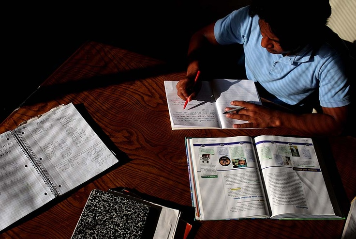 LOS ANGELES, CA - MAY 20, 2010: Jarlin Leonel Hernandez works on homework after school in one of the common rooms of the shelter. Jarlin, Melvin, and Alex all attend Roosevelt Senior High School in Boyle Heights. (Katie Falkenberg / For The Times)
