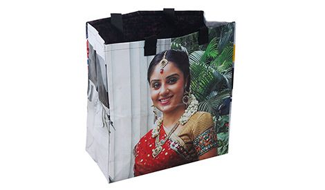 Slum dwelling women of Chennai made recycled billboard material into shopping bags. Bring Bollywood right to your home. More at newint.com.au/shop