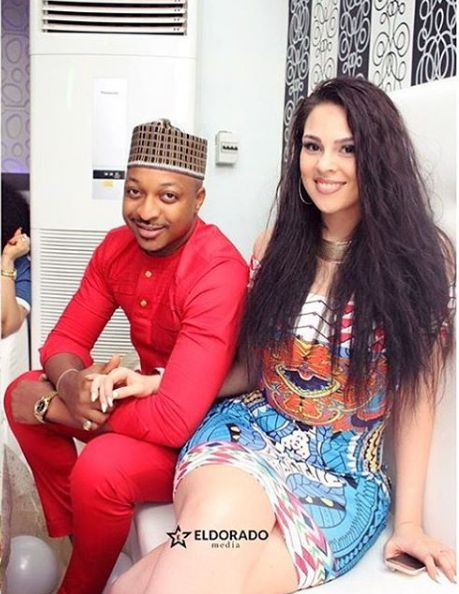 ActorIk Ogbonna and his Colombian wife look picture perfect at a friend's wedding over the weekend.Sonia shared the photo with a funny caption: Bad Gang @ikogbonna Aka SugaDaddy_No_Pot_Belle & his shameless Side Chick (obviously side chick who would marry her see how irresponsibly is she dressing smhis there anything she did not show us smh ) spotted (over)drinking Hennessy in public while celebrating @nikkyu birthday . No shame . Married man. Smh  ActorIk Ogbonna and his Colombian wife