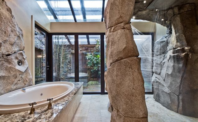 This master bathroom features a grotto style shower http