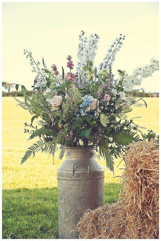 Devon wedding flowers in churn / http://www.deerpearlflowers.com/rustic-country-milk-jug-wedding-ideas/