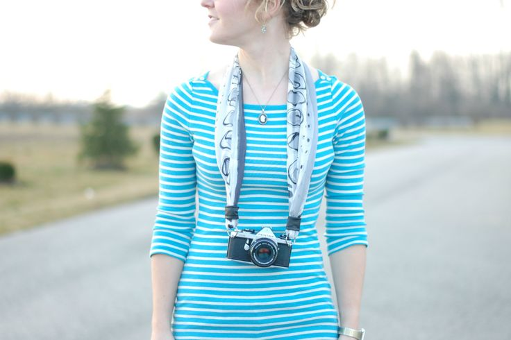 A camera strap from a scarf (could use any material, really). Much prettier than my black one that screams 'Canon'
