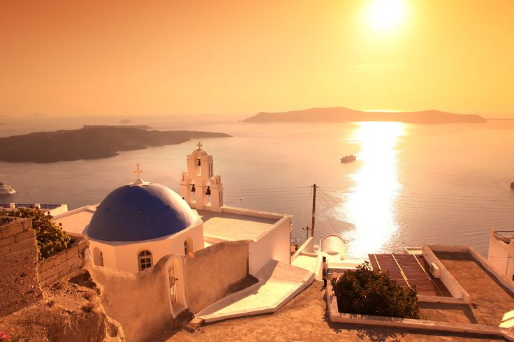 Sunset in Santorini, in front of a white church