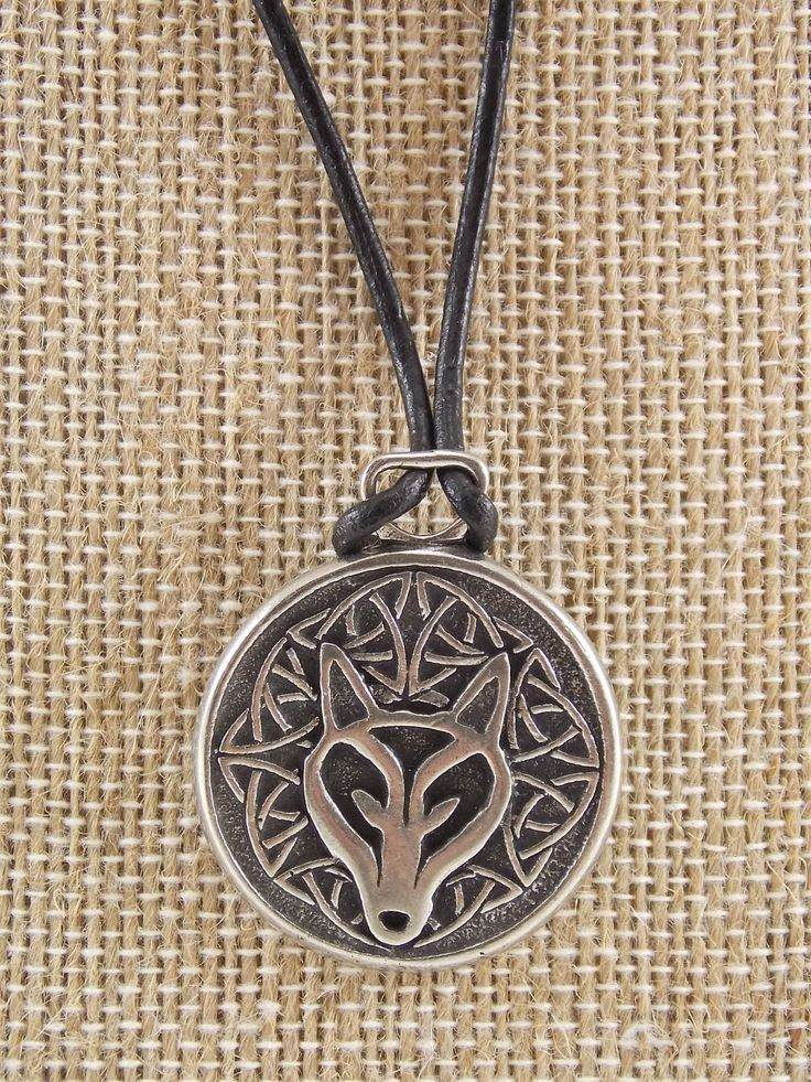 """This double sided wolf necklace with Celtic knot-work has an inspirational message on the back. """"The power within me is greater than any fear before me"""". - Lead free pewter- made in U.S. - 1 1/4"""" diam"""