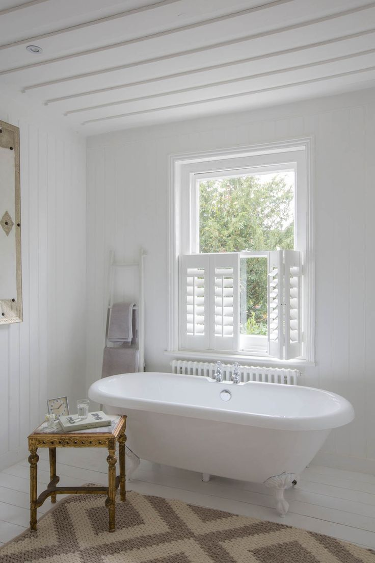 Bathroom Cafe-style shutters from Luxaflex | Apartment Apothecary