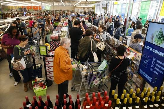 Glee at the supermarket checkout line over lower food prices isn't shared by all: Farmers, grocers and restaurateurs are feeling the pinch of cheap milk, beef and corn prices.